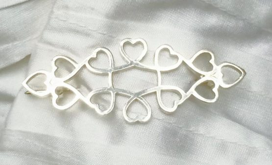 Adjoining Hearts Silver Stock Pin on White Pleated Silk Sock