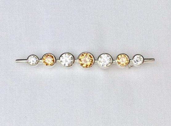 Our Graduated Stones Brilliant White Stock Pin is a simple design but has great impact. A fresh modern setting on a traditional stock pin bar. Solid 925 Sterling silver. Hand set with brilliant white colour top quality cz stones which produce the most stunning effect of beauty and elegance. Strong catch and pin for equestrian use. Designed and hand crafted in Great Britain. Carries the Stockpin Chic British hallmark and comes with its own Stockpin Chic bespoke presentation box. Available in various other colours. If you would like different stones or colours set in this stock pin to those available, we can do this for you. Please contact us for a quote and further information.