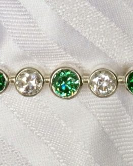 Emerald Graduated Stones Stock Pin