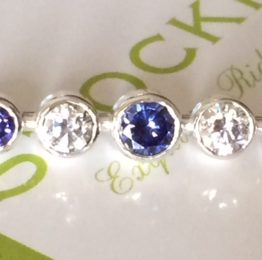 Graduated stones tanzanite silver stock pin