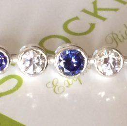 Graduated stones tanzanite silver stock pin