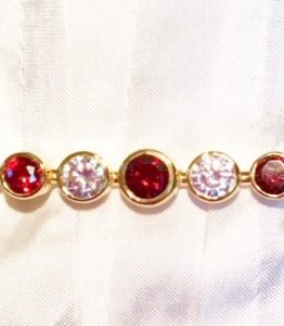 Gold garnet plated graduated stones stock pin