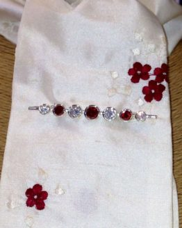 Ivory embroidered crimson cluster flower silk stock accessorised with our garnet graduated stones stock pin